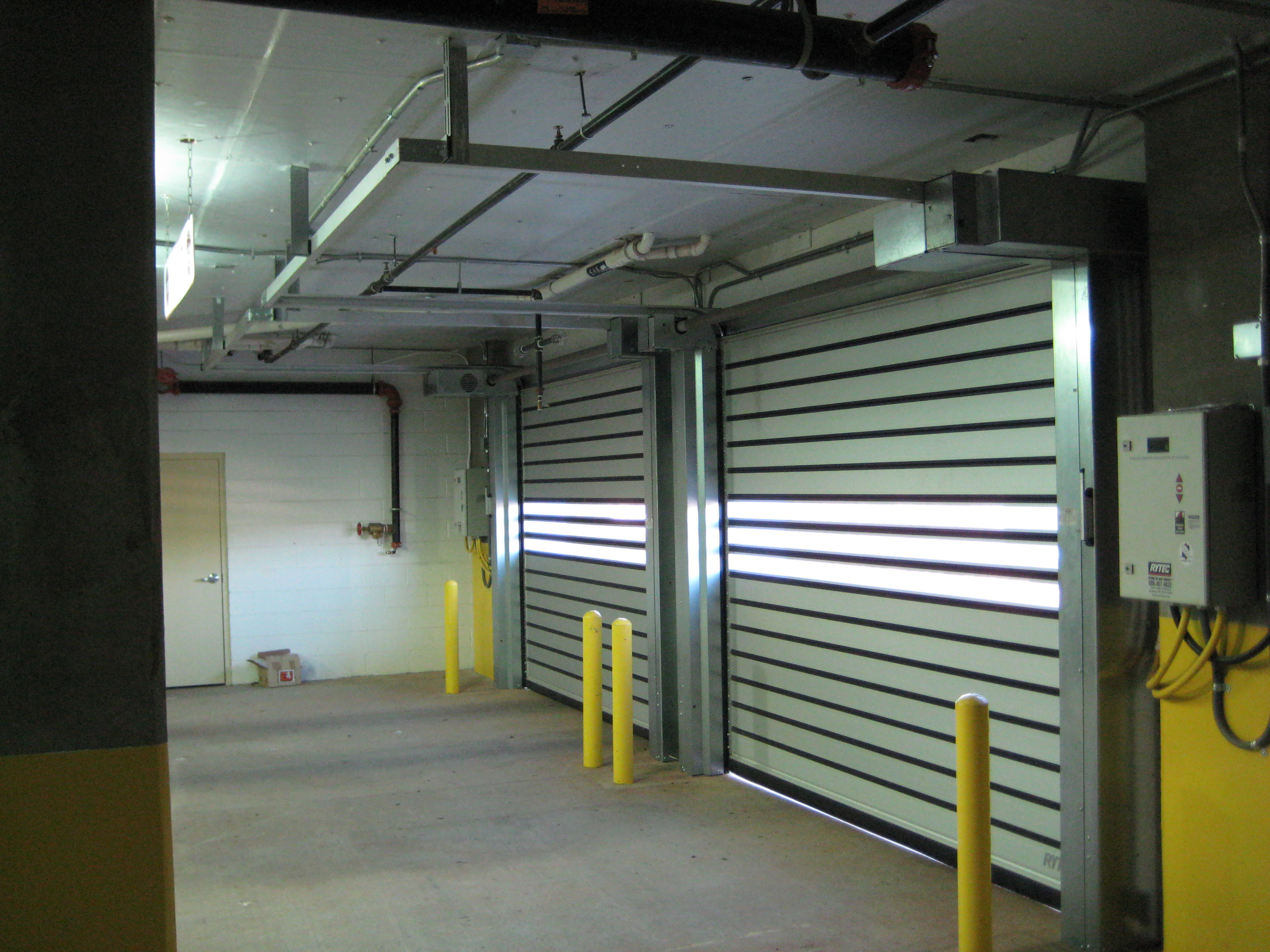 Quick Guide Low Headroom Sectional And Rolling Door Products For Tight Space Environments