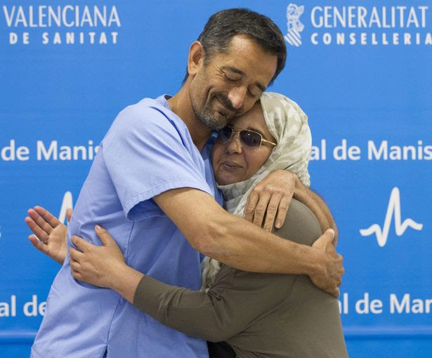 Moroccan Samira Benhar who suffered from a severe deformity due to a facial tumour which caused her social rebuff in her own country, embraces Spanish surgeon Pedro Cavadas after she explained the facial reconstructive surgery she underwent at Manises Hospital in Valencia
