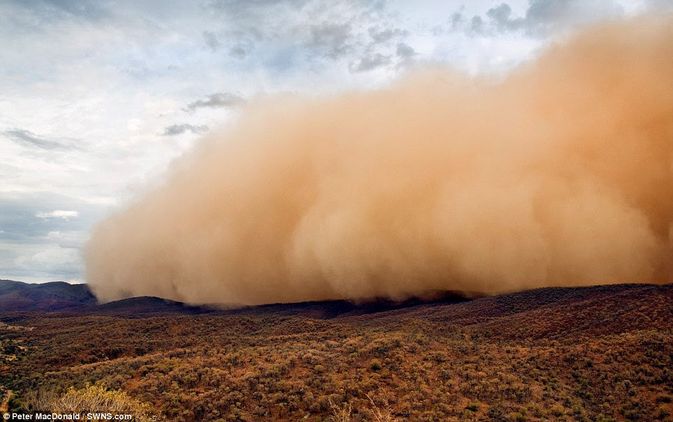 September: A massive dust storm rolls over the Arkaroola Wilderness Sanctuary in the northern Flinders Ranges of South Australia, in this stunning photograph by Peter MacDonald