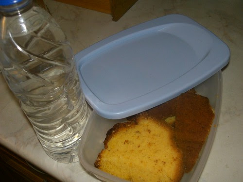 home made cake and a bottle of water