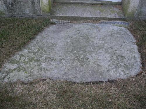 Field stone in front of lower door by midgefrazel