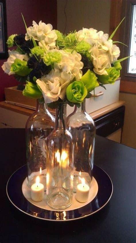 Wine bottle flower arrangement   Wedding   Pinterest
