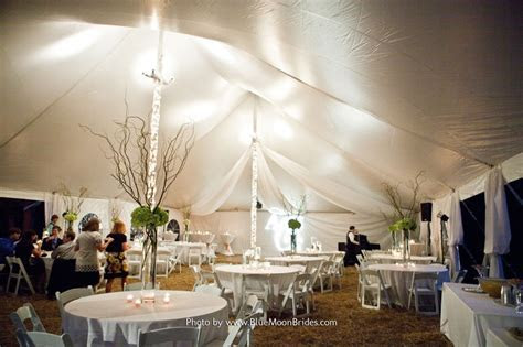 Ideas for wrapping tent poles in lights and tulle   Bridal