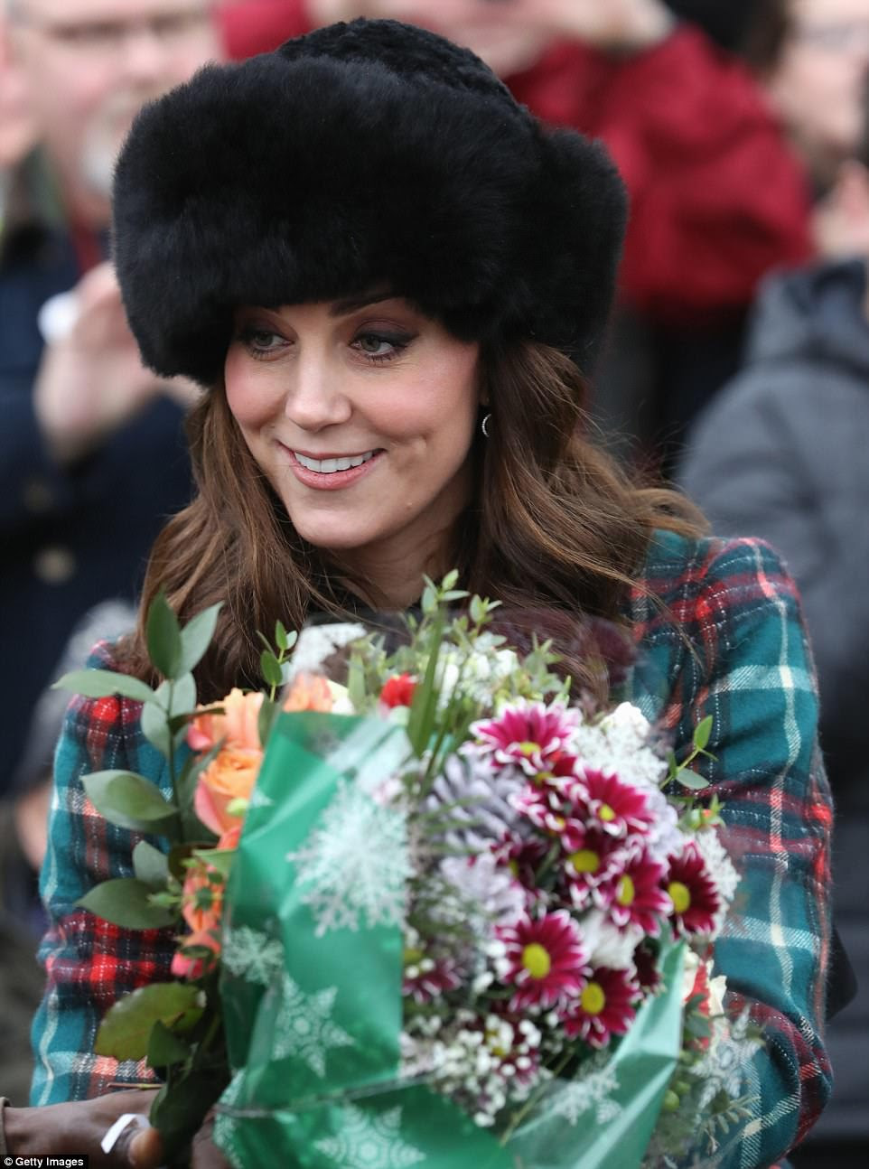 At one point following the Christmas Day service, Kate was handed a beautiful bunch of flowers by a well-wisher