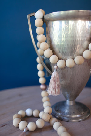 wood-bead-and-tassel-garland-DIY-via-cocokelley_5