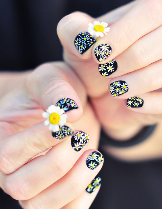 DIY Daisy Nail Art on black manicure