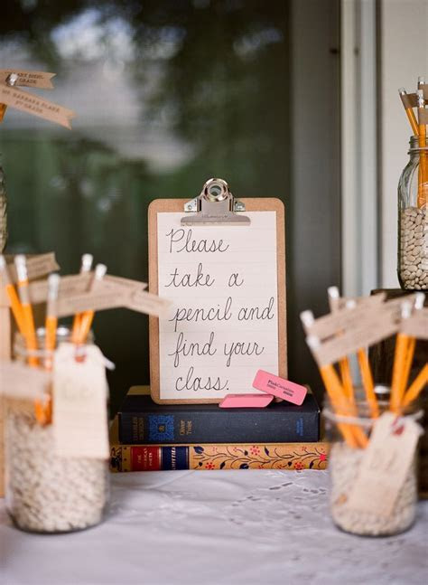 Pencil escort cards for a school themed wedding. Photo