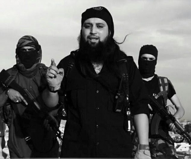 Feared: The latest photograph shows Belgian Hicham Chaib, 31 (centre) dressed in the all black uniform of ISIS' religious police force, which he is understood to lead in the group's de facto capital Raqqa