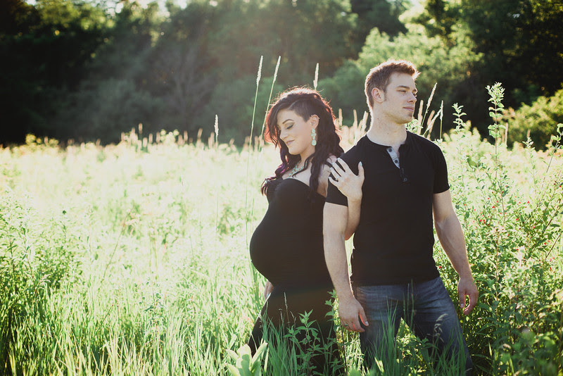 Maternity Photos by Mindy Joy Photography in Rockford IL in an outdoor setting with great sunlight. Photos taken in a field, photos taken in a creek, and photos taken in a covered bridge by one of Rockford IL's photographers