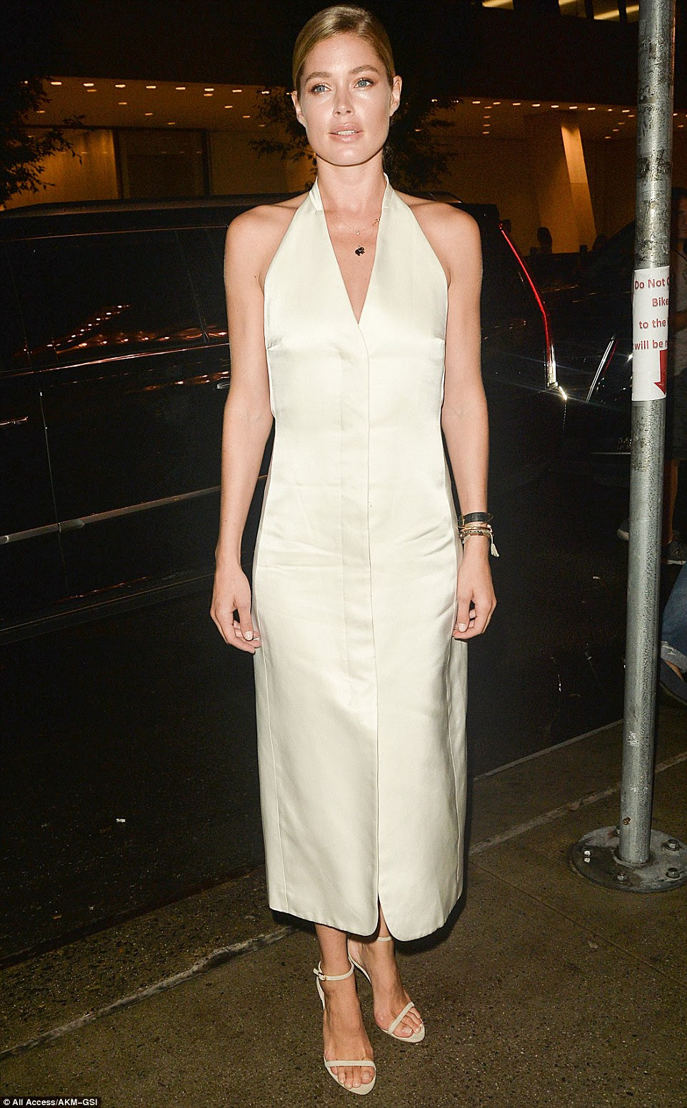 Angelic: Victoria's Secret Angel Doutzen Kroes was a vision in white as she headed to the event alongside her fashionable peers