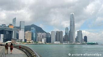 Panoramic view of the Victoria Harbor and skyscrapers and high-rise buildings in Central, Hong Kong, China, 27 June 2012. Chinas State Council, or the Cabinet, announced in late June measures aimed at boosting Hong Kongs anemic economic growth. The Cabinet said it will promote Hong Kongs status as a center for offshore finance using the mainlands tightly controlled currency, the yuan. It promised to encourage closer trade, education, science and technology, tourism and investment links.