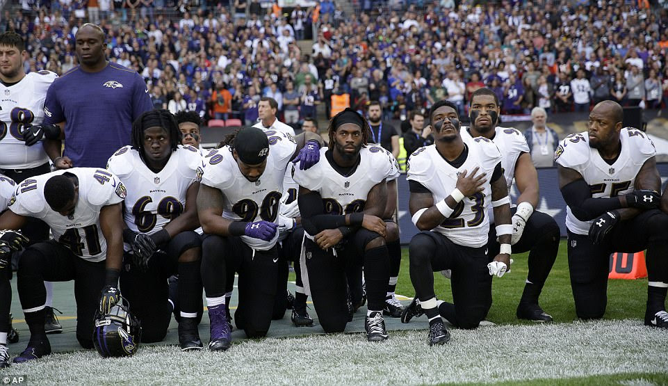 American football stars?defy?Trump by dropping to their knees during US national anthem (photos)