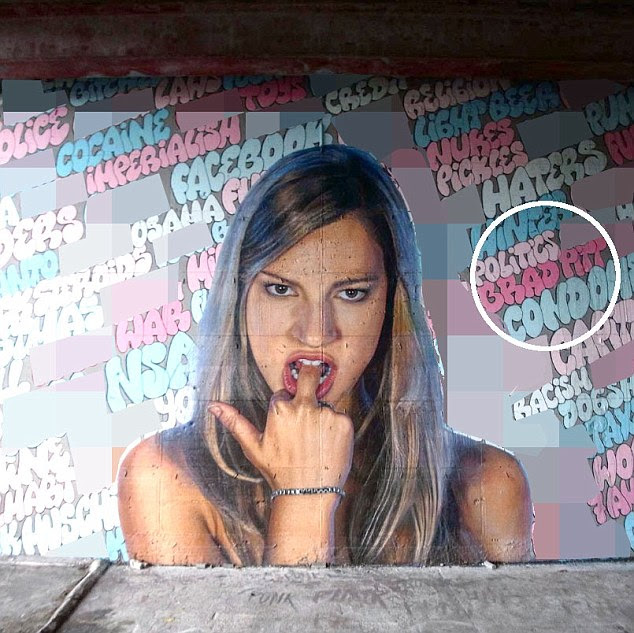"""Sentimentos verdadeiros?  A 45-year-old actor partilhada um design grafite pelo artista rua Nick Flatt para expressar seus sentimentos em torno a próxima eleição presidencial, e os fãs de olhos de águia foram rápidos em notar que contou com o slogan """"F ** k Brad Pitt '"""