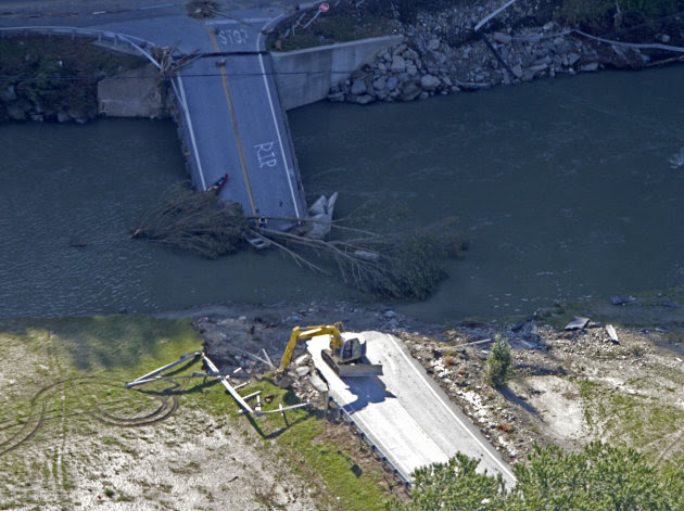 A bridge on Route 73 lies in the river in this aerial view on Tuesday, Aug. 30, 2011 in Rochester, Vt. All access to the town has been cut off.  National Guard helicopters rushed food and water Tuesda