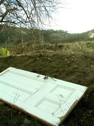 broken door on a hillside