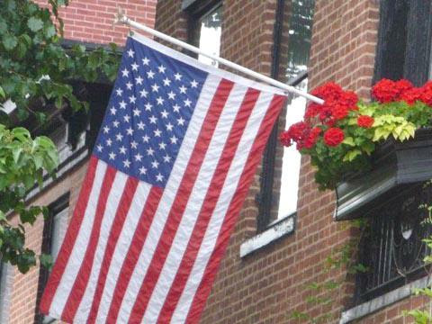 Flag and geraniums HomeRome Realty