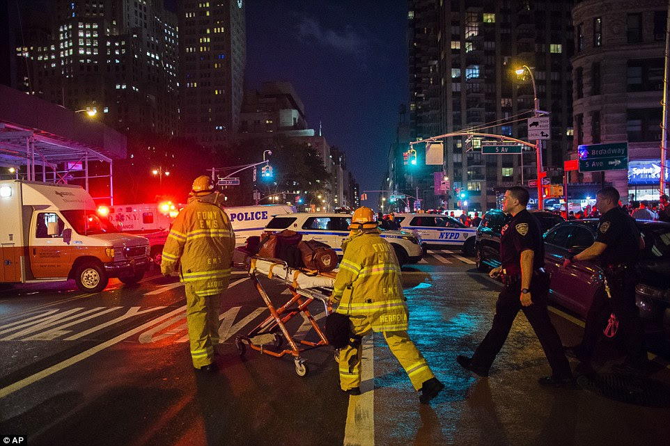The blast at 23rd Street and Sixth Avenue in Chelsea around 8.30pm is thought to have come from a dumpster and was the result of 'an intentional act', according to the NYPD. First responders work near the scene of the explosion