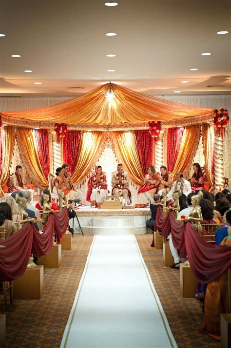 red and gold open style mandap   Wedding inspiration
