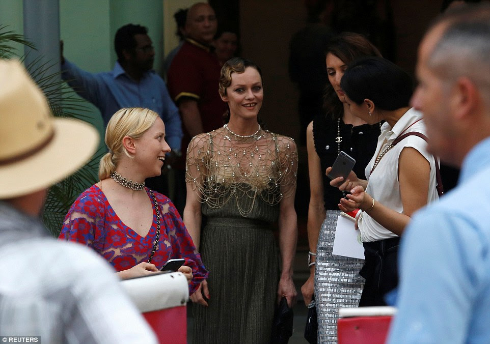 French singer Vanessa Paradis (center) walks towards a vintage car to attend a fashion show by Chanel in the Paseo del Prado