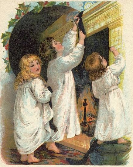Children Hanging Christmas Stockings