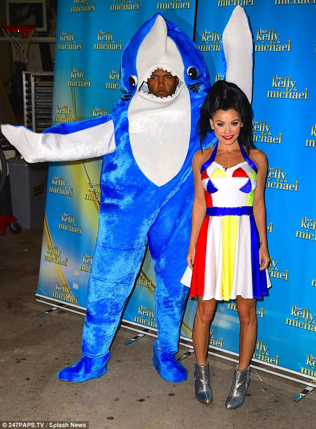 Baby you're a firework! Kelly took on Katy Perry's look from her Super Bowl performance while Michael nailed it as the infamous 'left shark'