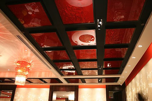 Even the ceiling's got beautiful, rich, decorative glass tiles