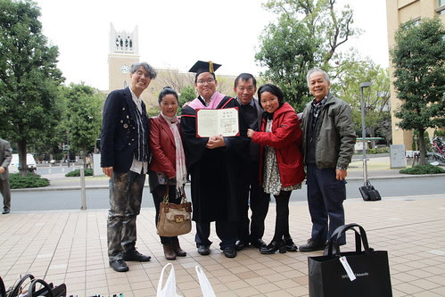 With family, Professor Ando and Uncle Yaw. After my graduation ceremony.