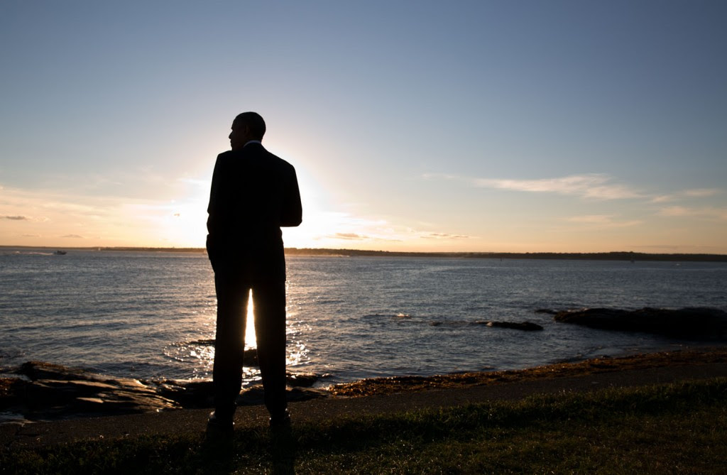 President Barack Obama looks out at the sunset at Brenton Point in Newport, R.I., August 29, 2014. Photo: Pete Souza / White House