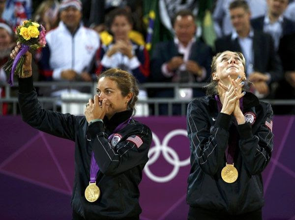 Misty May-Treanor and Kerri Walsh conclude their Olympic beach volleyball careers with gold medals on August 8, 2012.