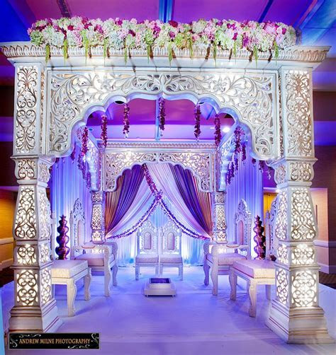 Mandap with beautiful purple rustic draping. Indian