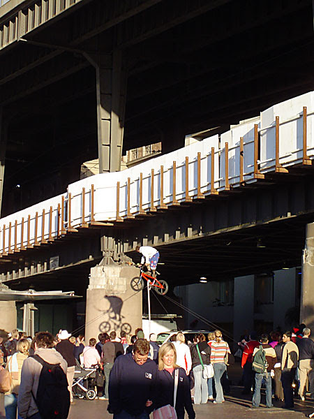 Juggler balancing above the crowd