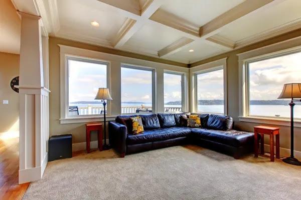 Living room wih many large windows and blue sofa. | Stock Photo ...