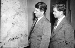 Sir Edmund Hillary and Mr George Lowe , both members of the successful Everest Expedition , studying a chart of the Antarctic during their London talks .