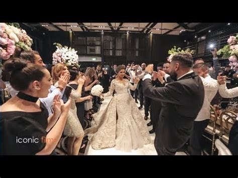 Glamorous wedding entry of bride and groom with Lebanes