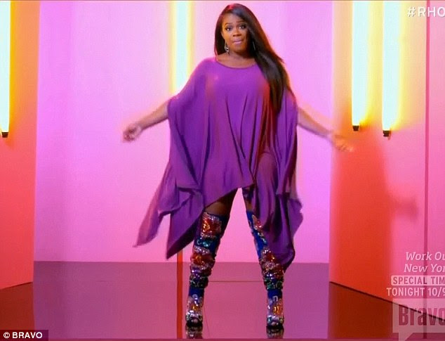 Covered up: Kandi wore loose clothes to cover up her baby bump in the music video