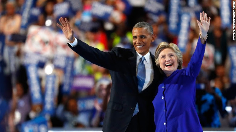 Clinton and U.S. President Barack Obama wave to the crowd Wednesday after Obama gave a speech.