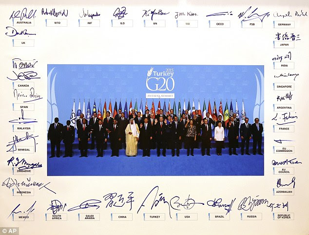 World leaders each signed their names around the frame of a family photograph taken to mark the end of the two-day conference
