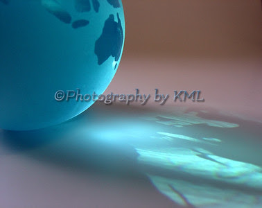 the reflection of blue light from a glass globe