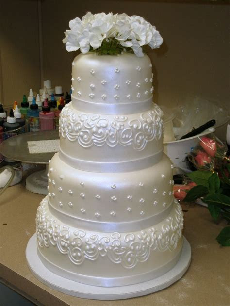 Four Tier Round Custom White Fondant Wedding Cake Design