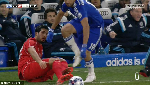 Chelsea striker Costa (right) moves towards the ball after  Can takes a tumble off the pitch