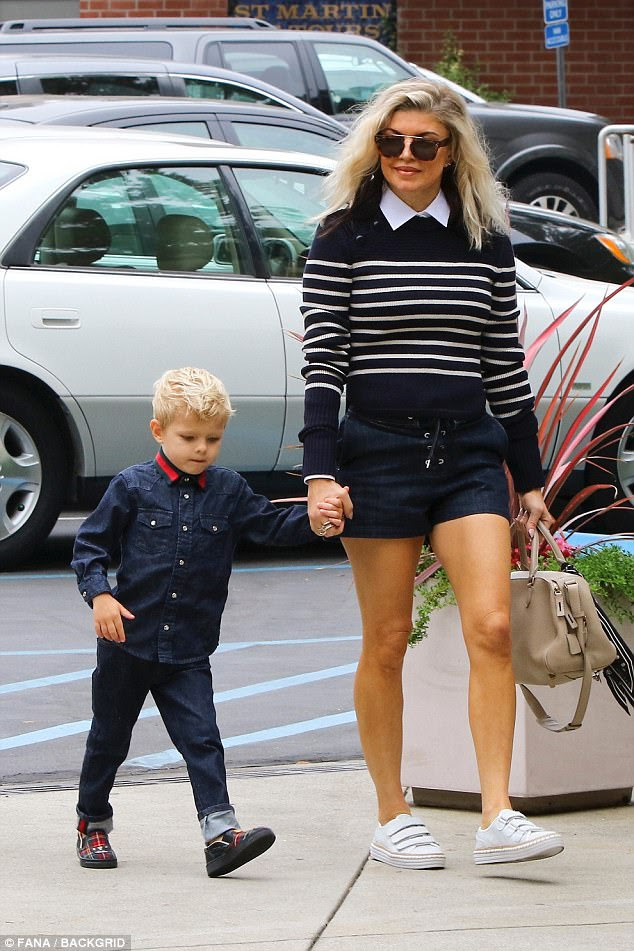 Family time: Fergie cut a chic figure when she headed to church this Sunday in Los Angeles, leading her three-year-old son Axl by the hand