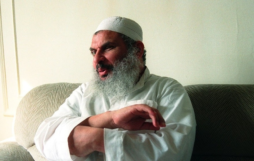 "Sheik Omar Abdul Rahman answers questions during a February 20, 1993, interview.  Sheik Omar Abdul Rahman said in a March 5, 1993 statement that he ""unequivocally denounced the bombing.""  Reuters/Mike Segar - RTR1DBX6"