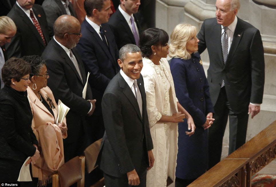 No hangover here! President Obama, his wife Michelle and the Bidens looked in good spirits as they attended the Presidential Inaugural Prayer Service at the National Cathedral in Washington on Tuesday morning