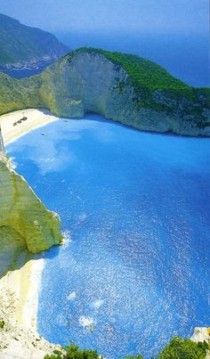 Zakynthos, Ionian Island, Greece Been & done - stood on the beach next to the shipwreck & yes the water is that BLUE ! Visited x 2 holidays Honeymooned here, dad died whilst I stayed on second visit. Still a lovely place to visit tho !
