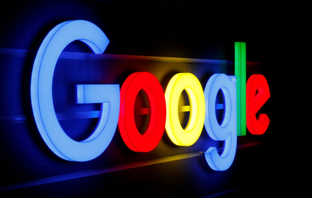 An illuminated Google logo is seen inside    an office building in Zurich in this file photo. â€