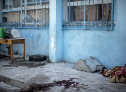 A trail of blood is seen in the courtyard of a UN School in the northern Beit Hanun district of the Gaza Strip on July 24, 2014, after it was hit by an Israeli tank shell. At least nine people were killed, including a baby, when an Israeli tank shell slammed into a UN-run school in the northern Gaza Strip, an AFP correspondent said. AFP PHOTO/MARCO LONGARI        (Photo credit should read MARCO LONGARI/AFP/Getty Images)
