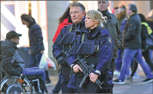 police officers patrol in dortmund germany on tuesday a truck ran into a crowded market in ...