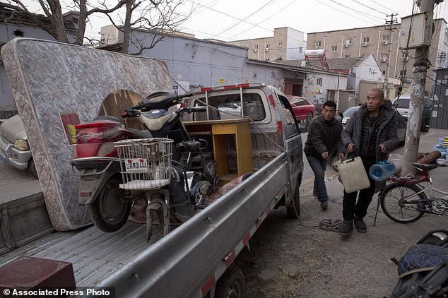 Image result for Beijing evictions of migrant workers stir widespread anger