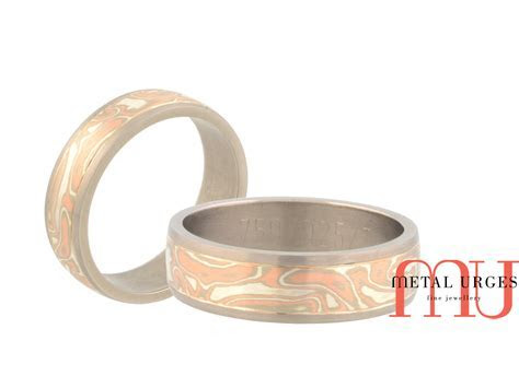 Mokume gane mens wedding ring featuring 18ct rose, white