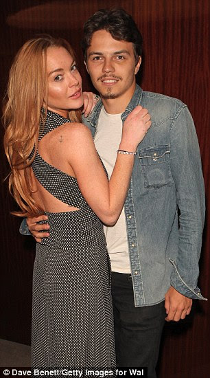 Lindsay Lohan (pictured with Egor Tarabasov) is facing bankruptcy after failing to pay rent on her £3.5million London flat